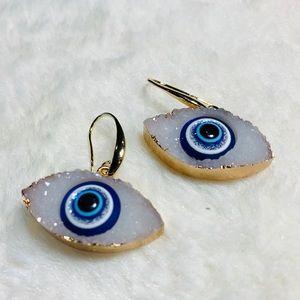 White evil eye earrings